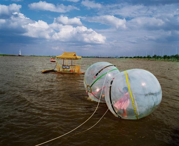 Girl in Bubble. 'Bitter Waters'. National Geographic, May 2008